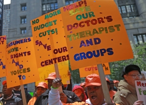 Cheryl Wallington (right) participates in a rally at the Thompson Center against budget cuts to mental health programs on May 13, 2014.